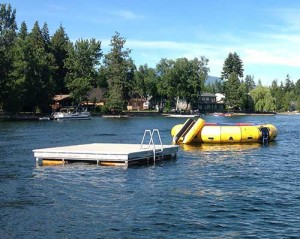 Swim raft and water trampoline on lake