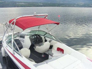 Interior view of red Malibu ski and wakeboard boat