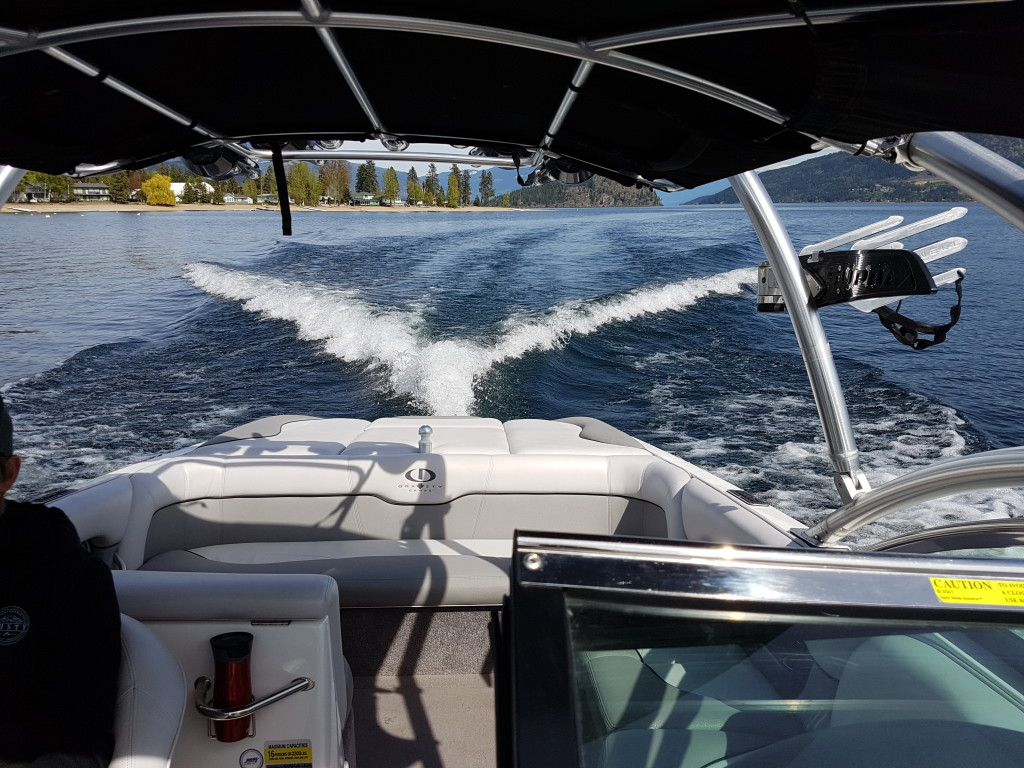 View towards the back of moving wake surfing boat